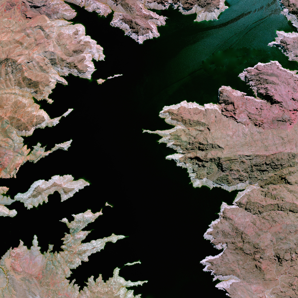 6/25/2015   Lake Mead   Mohave County, Arizona / Clark County, Nevada  36.25°N 114.39°W     Lake Mead—located on the Colorado River 24 miles southeast of Las Vegas, Nevada—is the largest reservoir in the United States. The lake was formed with the creation of the Hoover Dam in the 1930's. Due to a combination of drought and increased water demand in the surrounding states (specifically California, Nevada, New Mexico, and Arizona) the lake's water level is lowering drastically. Yesterday, water levels at the lake reached a record low of 1075 feet, only 25 feet above one of the major intake pipes for Las Vegas' supply of drinking water.