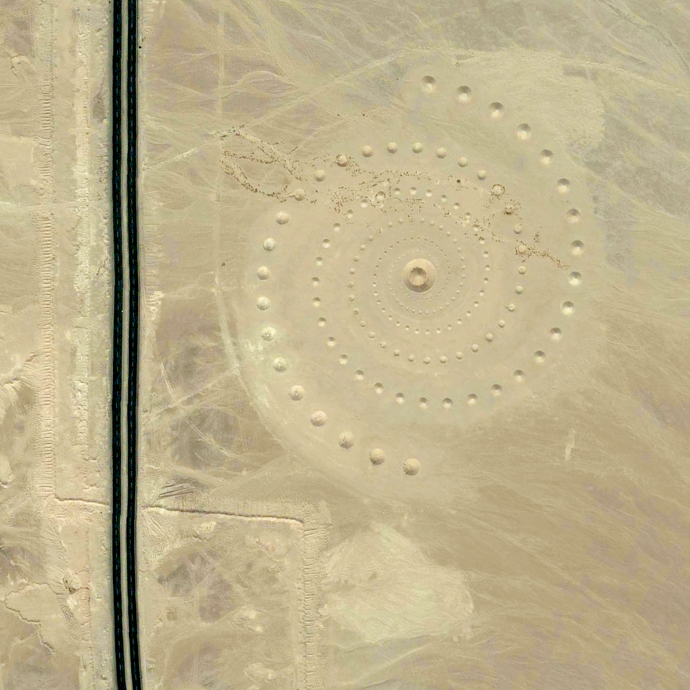 "8/8/2015 Desert Breath Hurghada, Egypt 27.380541787°, 33.634132451°   ""Desert Breath"" - located in the Egyptian desert near Hurghada on the Red Sea - is a double-spiral art piece. Because the 89 protruding cones that make up one spiral are constructed from the sand that was dug to create the 89 depressed cones of the other spiral, in due time, with erosion, the area of approximately one million square feet will revert back to its original state."