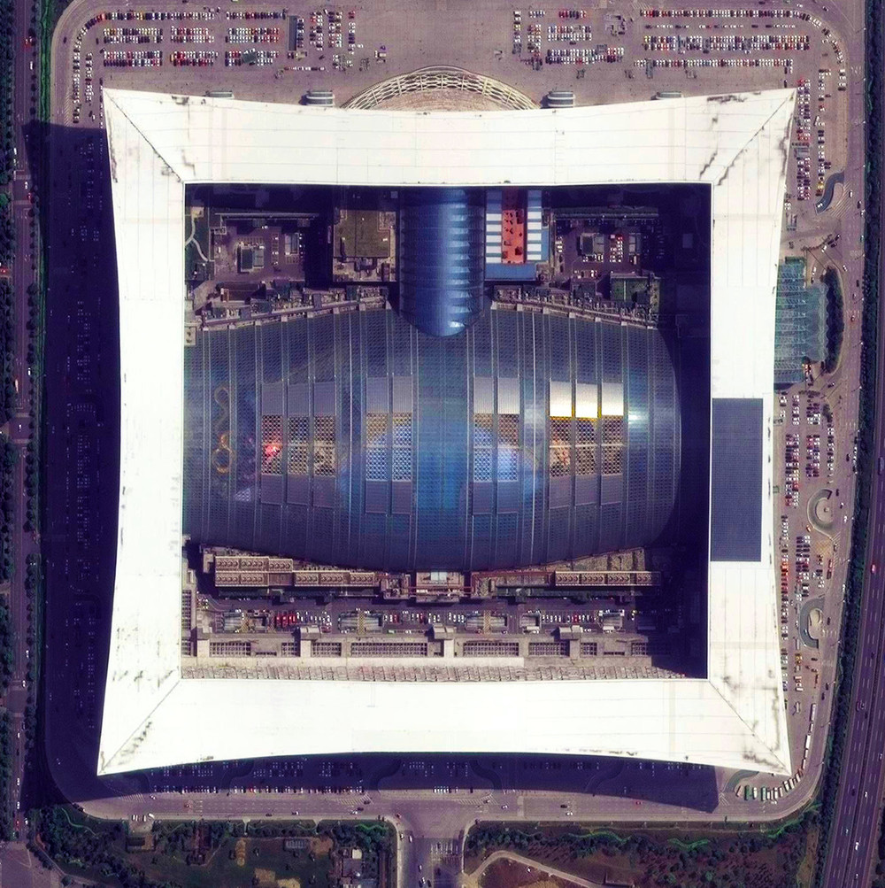 "8/12/2015   New Century Global Center   Chengdu, China  30° 34' 20"" N, 104° 3' 39"" E     This morning I'll fly to Chengdu, China. The city is home to the recently constructed New Century Global Center - a multipurpose facility that contains numerous shopping malls, an IMAX cinema, a ""mediterranean village,"" a pirate ship, a skating rink, and a 500x130 foot screen that displays artificial sunrises and sunsets. The structure contains the largest amount of floor space for a single building with approximately 18 million square feet."