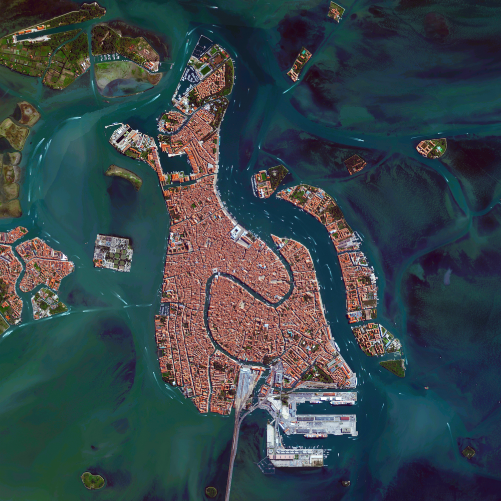 9/28/2015 Venice Venice, Italy 45°26′15″N 12°20′9″E   We have an incredible set of Overviews that I'll be adding to our Printshop tomorrow and wanted to give you all a sneak peek of what's to come! One of these Overviews - Venice, Italy - shows how the city is situated upon 118 small islands that are separated by canals and linked by bridges. With tide waters expected to rise to perilous levels in the coming decades, the city has constructed 78 giant steel gates across the three inlets through which water from the Adriatic could surge into Venice's lagoon. The panels – which weigh 300-tons and are 92ft wide and 65ft high - are fixed to massive concrete bases dug into the seabed.