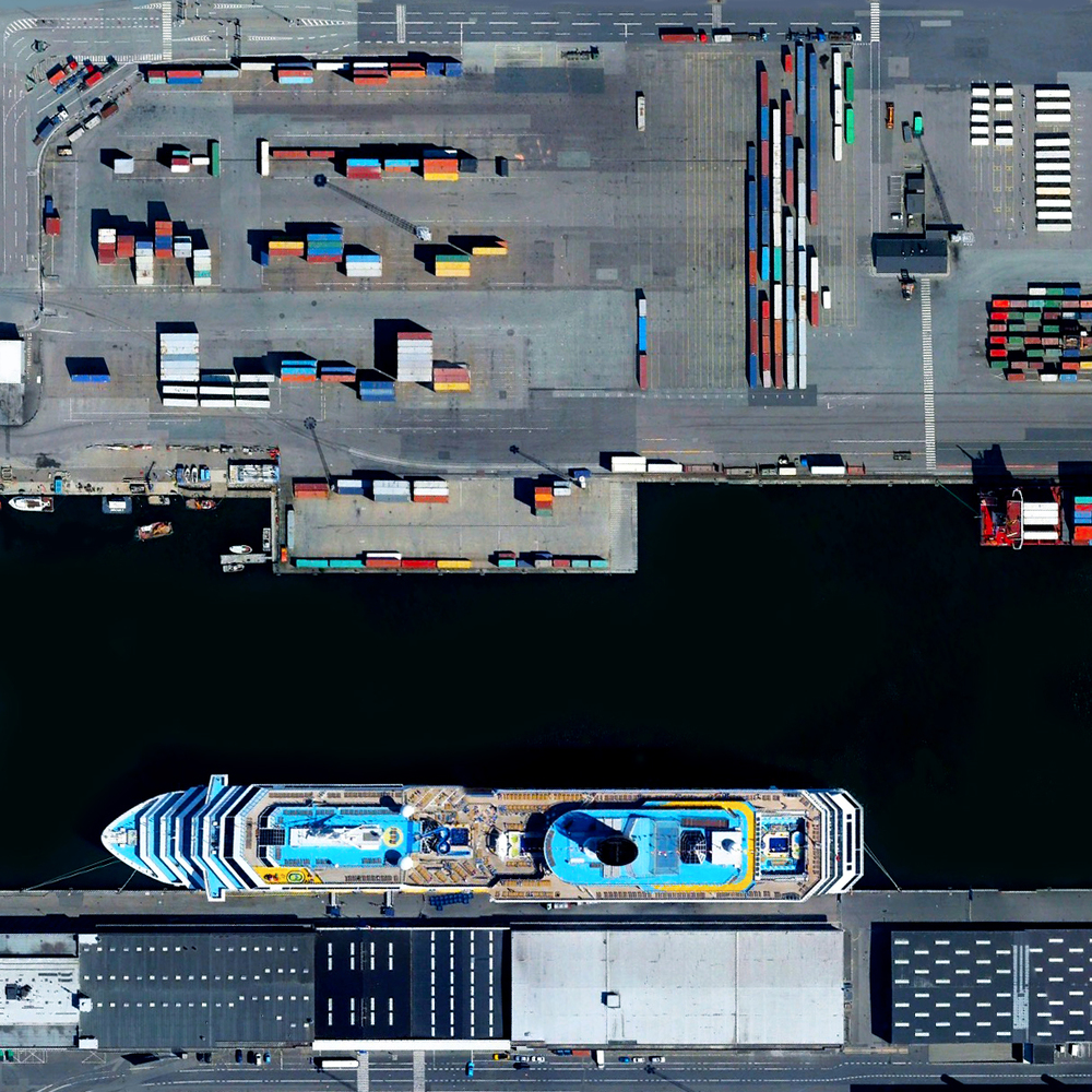 10/2/2015 Port of Copenhagen Copenhagen, Denmark 55.6718°N 12.5817°E   The Port of Copenhagen in Copenhagen, Denmark has one of the largest passenger terminals in the Baltic Sea, handling more than 1.6 million passengers annually. A cruise ship with an approximate length of 1000 feet (305 meters) is seen at one of its docks. The facility also contains one of the region's busiest cargo terminals, which moves more than 18 million tonnes of cargo each year.
