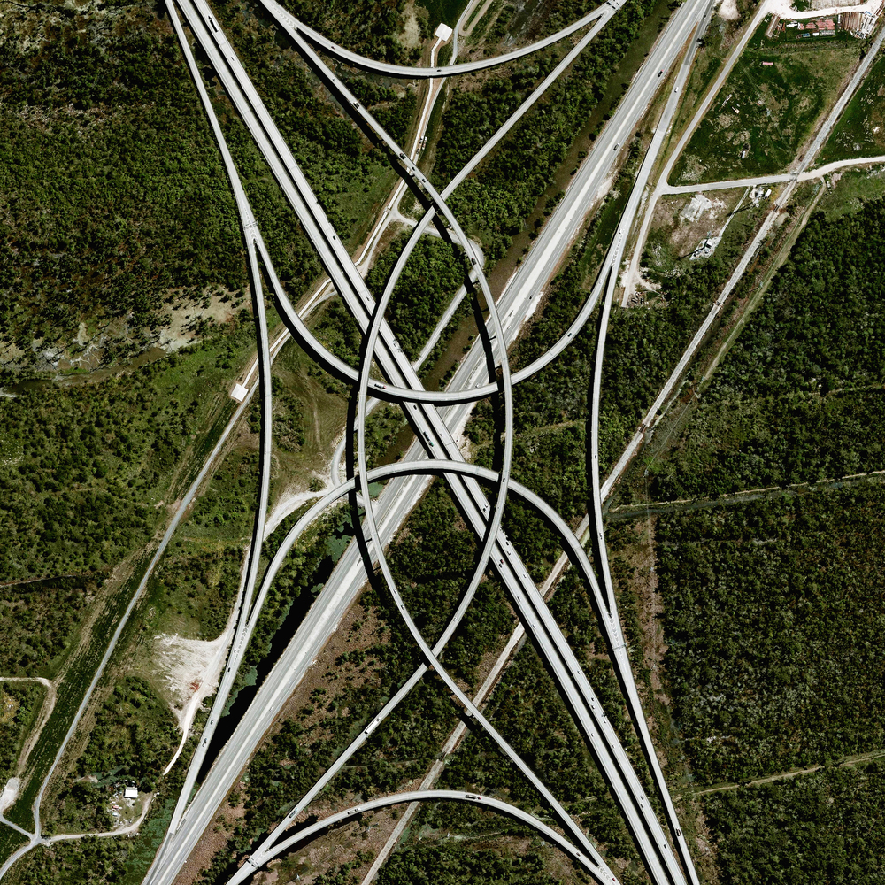 10/3/2015  Highway interchange  New Orleans, Louisiana, USA  29.975279589°, -90.319193923°     A highway interchange connects Interstate 310 and U.S Route 61 outside of New Orleans, Louisiana, USA. Because the roadways in this area were built on top of environmentally sensitive wetlands, construction platforms were mounted on top of concrete piles to minimize disruption with the terrain below.