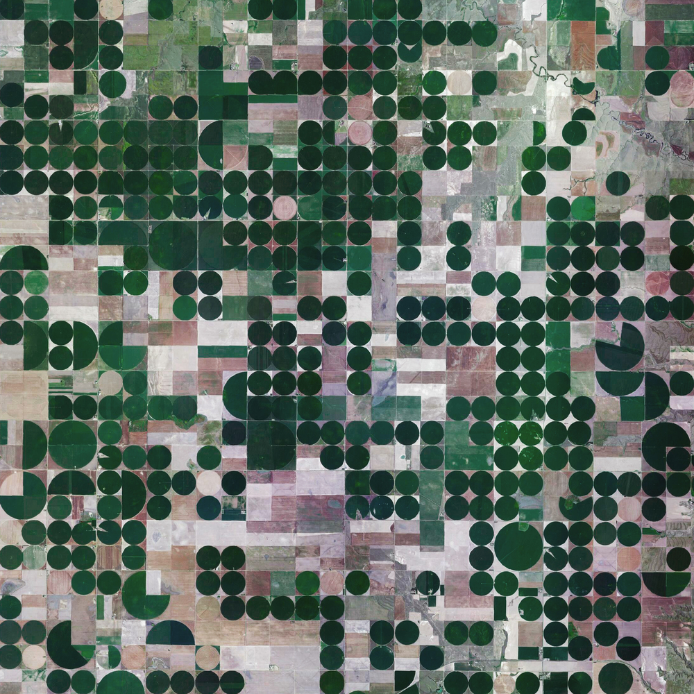 10/7/2015 Pivot irrigation fields Copeland, Kansas, USA 37.631919632°, -100.706841568°   Pivot irrigation fields cover the landscape north of Copeland, Kansas, USA. Powered by electric motors, lines of sprinklers rotate 360 degrees to evenly irrigate crops.