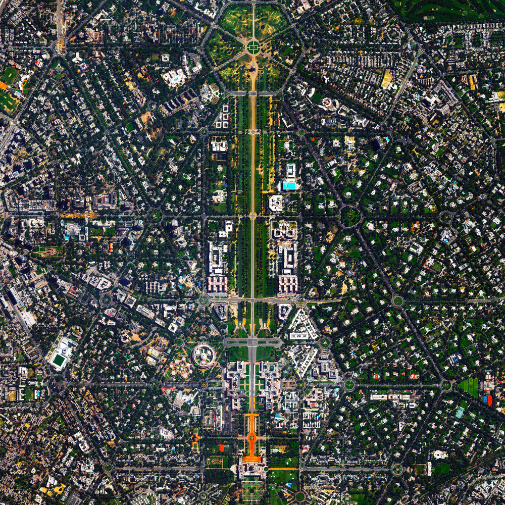 10/16/2015 New Delhi New Delhi, India 28.613025571°, 77.225124376°   New Delhi serves as the capital of India and is home to more than 21 million residents in its metro area. Officially inaugurated in February 1931, the city was planned by British architects Sir Edwin Lutyens and Sir Herbert Baker. Their design centered around two central promenades - the Rajpath and the Janpath - that run perpendicular to each other and intersect here at center. For a sense of scale, this Overview shows approximately four square miles.