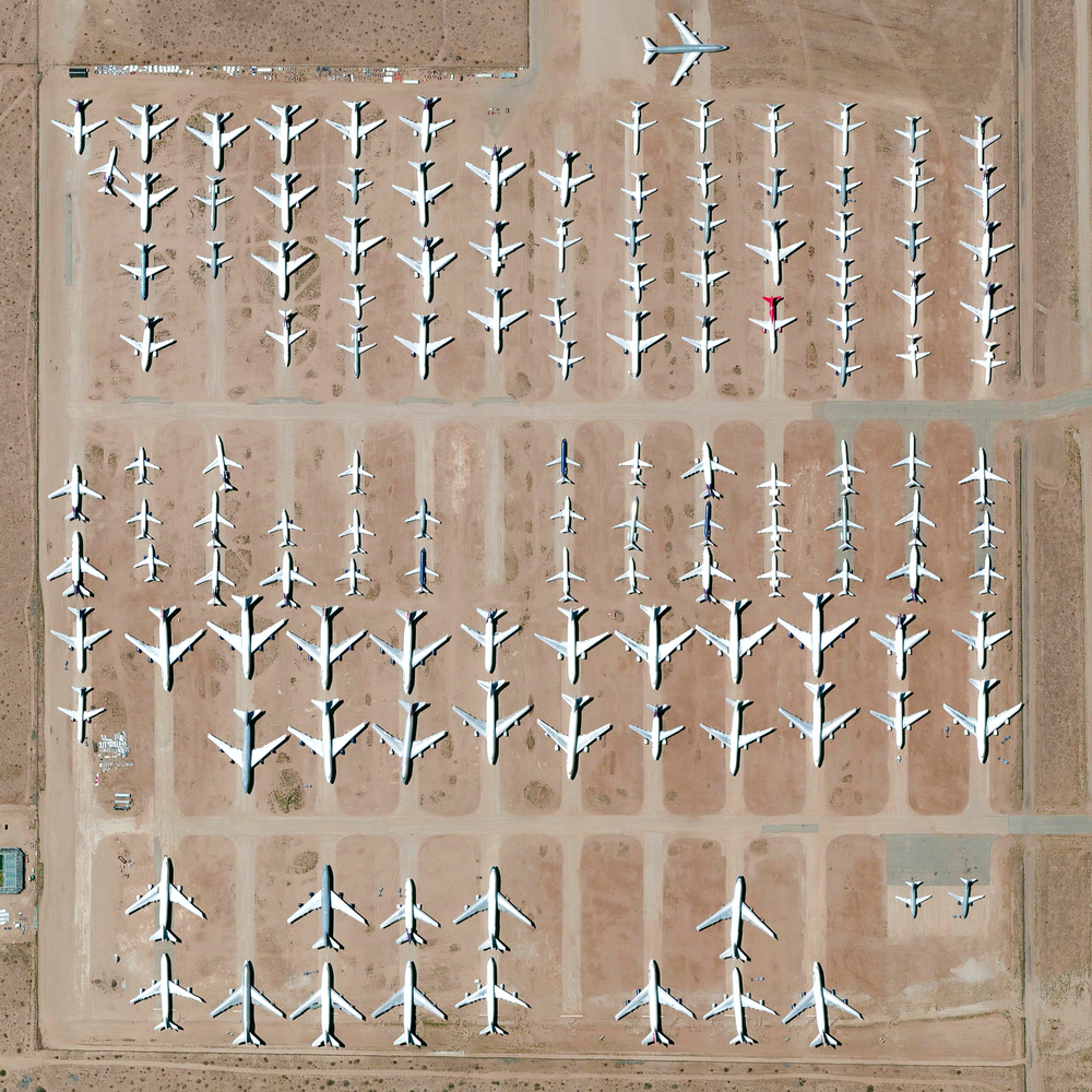 10/30/2015  Southern California Logistics Airport  Victorville, California, USA  34°35′51″N 117°22′59″W     To celebrate 150k followers we are doing a  print giveaway of this Overview on Instagram ! Here we see the Southern California Logistics Airport in Victorville, California, a massive transitional hub for commercial aircraft. The facility's boneyard contains more than 150 retired planes.