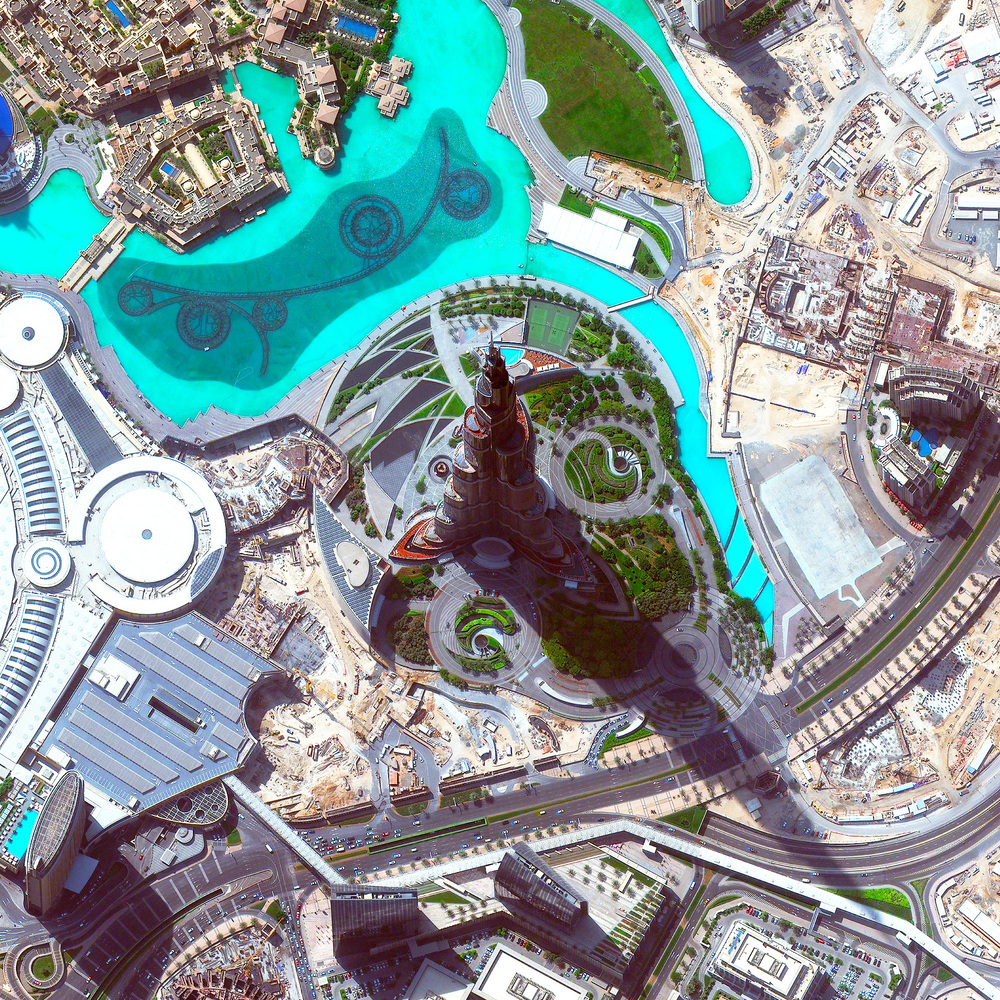 11/1/2015   Burj Khalifa   Dubai, United Arab Emirates  25°11′49.7″N 55°16′26.8″E     Standing at 2,717 feet (828m), the Burj Khalifa in Dubai, UAE is the tallest building in the world (and casts quite a long shadow!). The design of the 163-floor structure is an abstraction of the Hymenocallis, a type of desert flower that has long petals extending from its center. The building has been very well received since it opened in 2010; however, its construction was very controversial as it was built primarily by workers from South Asia and East Asia who earned low wages and were housed in abysmal conditions.