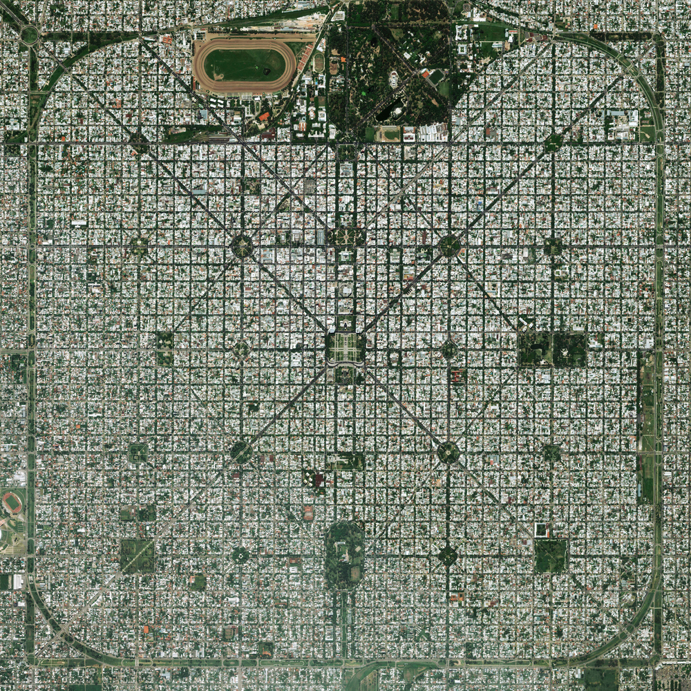 "11/6/2015   La Plata   Buenos, Aires, Argentina  34°55′16″S 57°57′16″W     The planned city of La Plata, the capital city of the Province of Buenos Aires, is characterized by its strict grid pattern. At the 1889 World's Fair in Paris, the new city was awarded two gold medals for the ""City of the Future"" and ""Better performance built."""