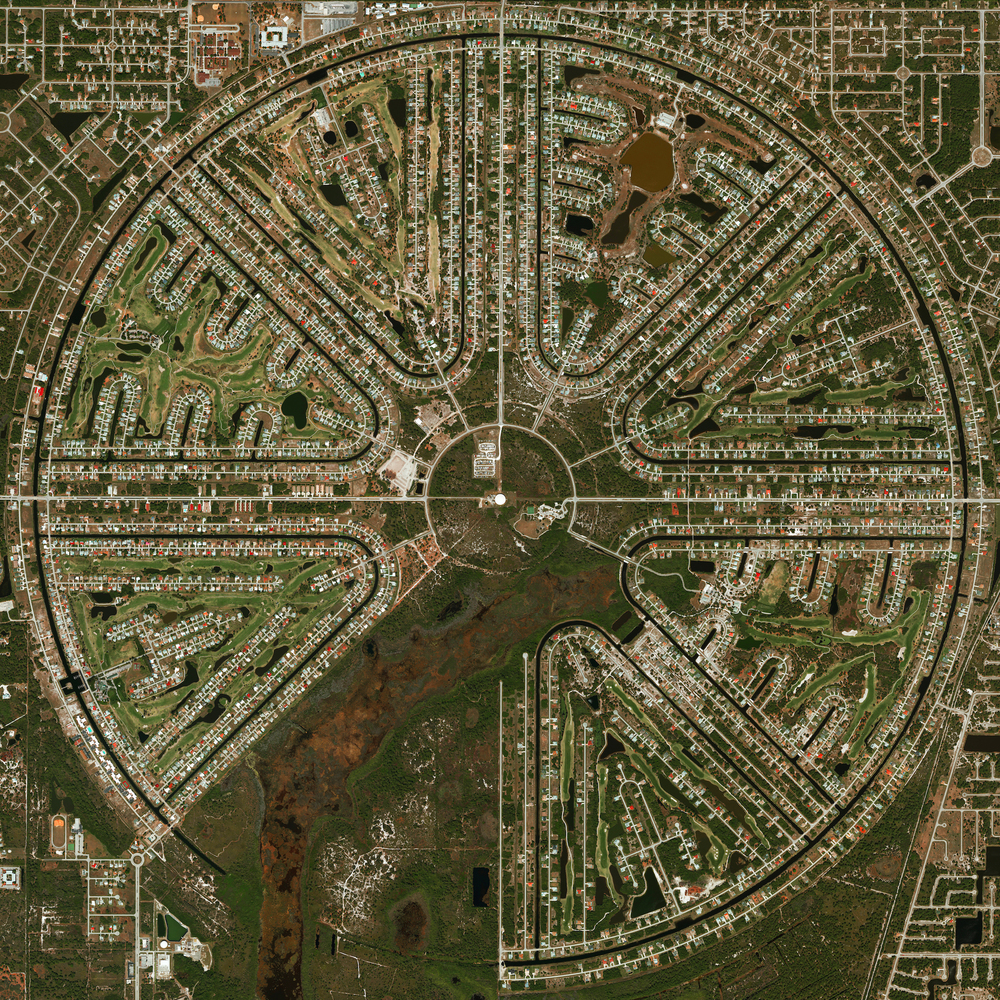 11/17/2015 Rotonda West Rotonda West, Florida 26°53′16″N 82°16′17″W   Rotonda West is an unincorporated community in Florida, USA that is shaped like an incomplete wagon wheel. A freshwater canal system surrounds the outside of the wheel and travels inside each of the pie-shaped wedges to form the subdivisions of the development. The wheel was not fully completed because the undeveloped area is a wetland is a habitat for a number of animals such as alligators, bald eagles, and great blue herons.