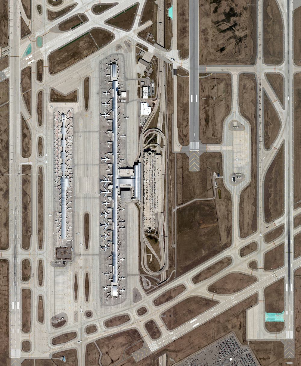 11/27/2015 Detroit Metropolitan Airport Romulus, Michigan 42°12′45″N 083°21′12″W   Detroit Metropolitan Airport covers more than 11 square miles in Romulus, Michigan. Concourse A at McNamara Terminal, seen here at left, is the world's second-longest airport terminal building, extending a length of one mile (Kansai Airport in Japan has a 1.7 mile long terminal). Detroit Metro is the 16th busiest facility in the United States, serving more than 32 million passengers each year.