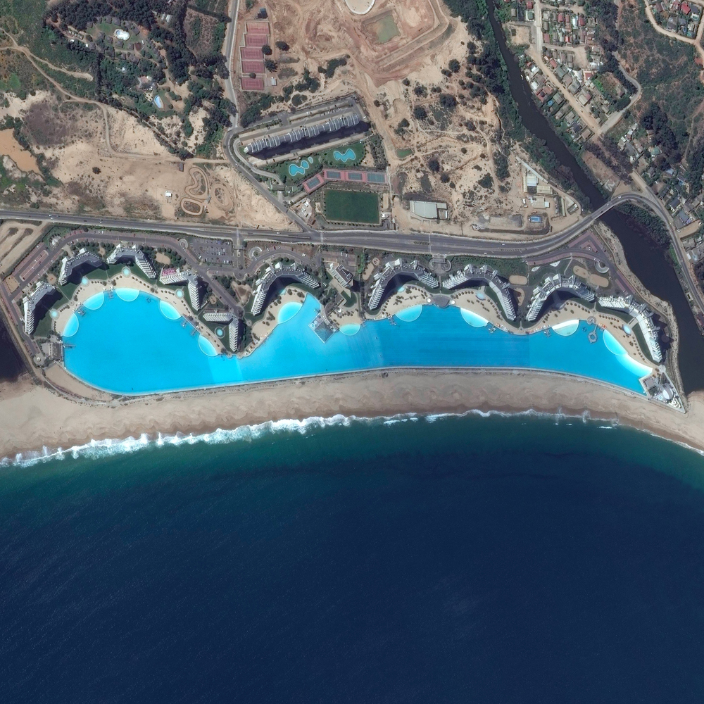 12/18/2015 San Alfonso del Mar Algarrobo, Chile 33°21′S 71°39.2′W   The swimming pool at the San Alfonso del Mar Resort in Algarrobo, Chile is the largest in the world. The pool is more than one thousand meters long (3,323 ft) and contains approximately 250 million liters (66 million gallons) of water! The resort pays $4 million dollars each year to maintain the pool.