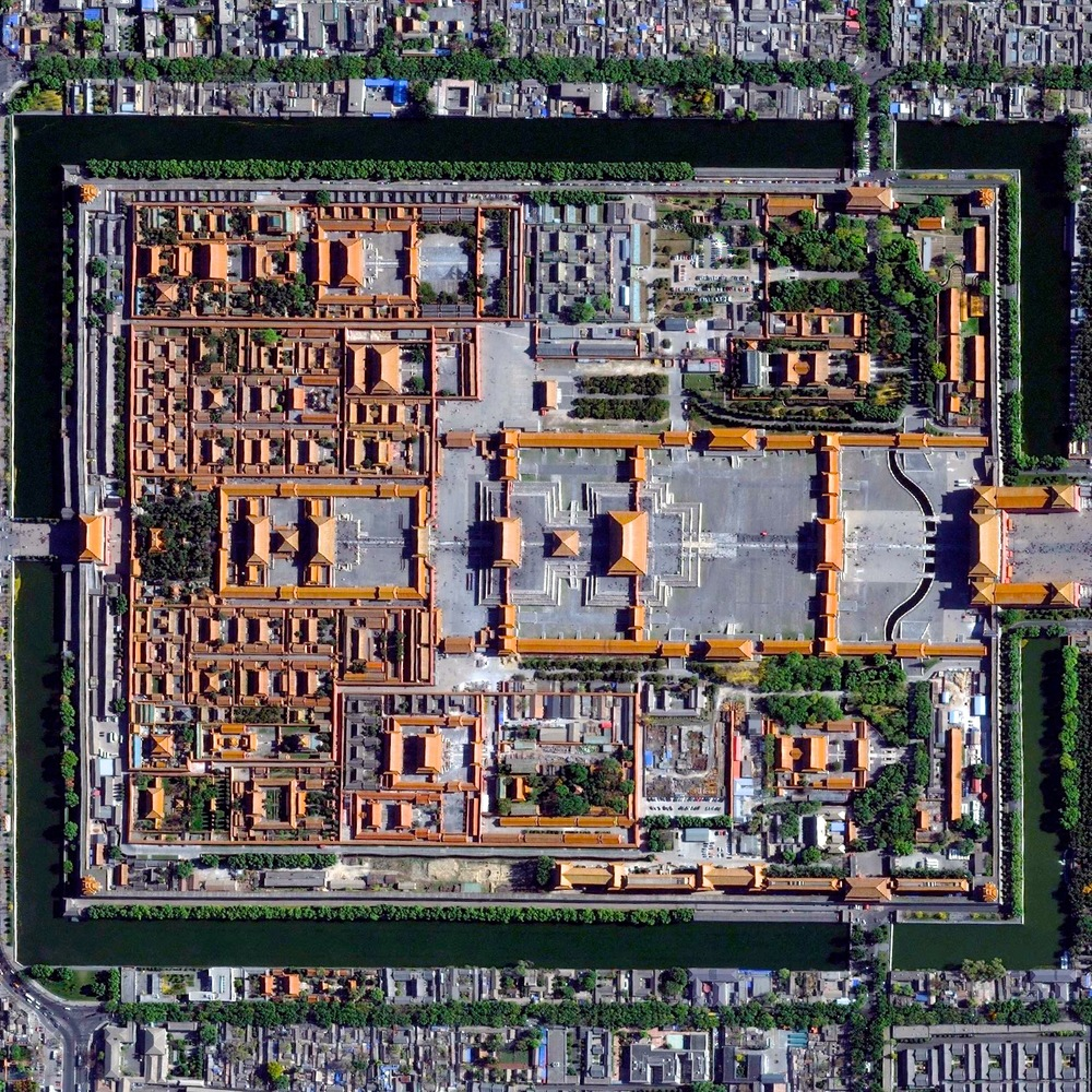 12/27/2015 Forbidden City Beijing, China 39°54′53″N 116°23′26″E   Here's another favorite Overview from 2015. The Forbidden City in Beijing, China was built from 1406 until 1420 by more than one million workers. The palace complex, which contains 9,999 rooms, is surrounded by walls and a moat that are 26 feet high and 171 feet wide, respectively.