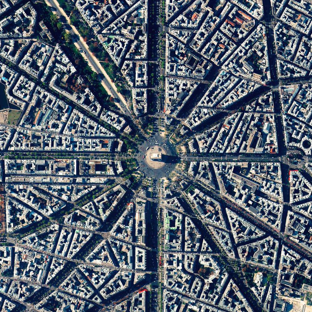 12/30/2015 Arc de Triomphe Paris, France 48.8738°N 2.2950°E   We're coming to the end of our favorite Overviews from 2015. The Arc de Triomphe is located at the center of twelve radiating avenues in Paris, France. Because of numerous delays such as the abdication of Napoleon, construction of the arch took nearly 30 years to complete.