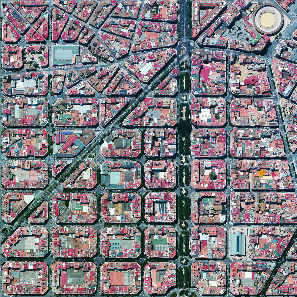 1/6/2015  L'Eixample  Valencia, Spain  39°27′53″N 0°22′12″W     The urban plan of the L'Eixample district in Valencia, Spain is characterized by long straight streets, a strict grid pattern crossed by wide avenues, and apartments with communal courtyards. A similar layout was used for the district of the same name in Barcelona. The circular structure in the upper right is the Plaza de Toros de Valencia - the city's largest bullfighting arena.