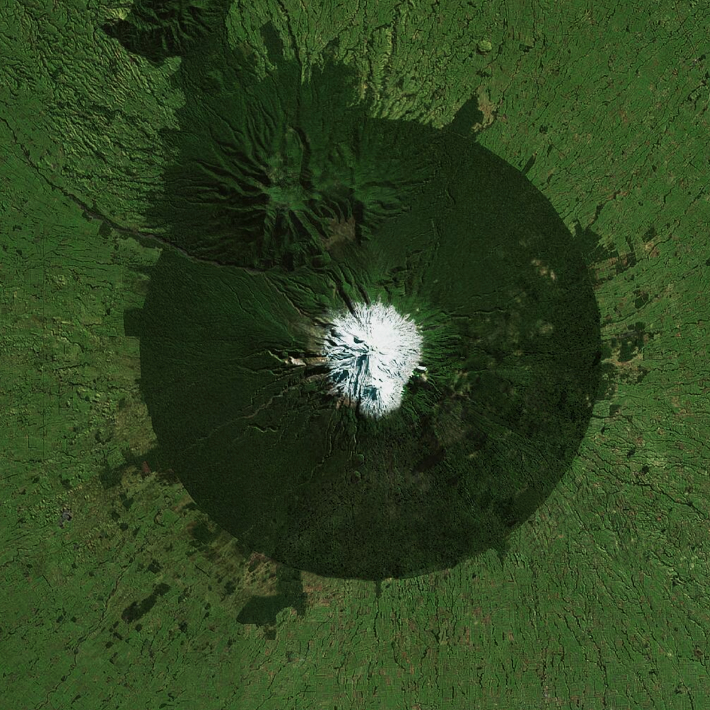1/8/2016   Mount Taranaki   North Island, New Zealand  39°17′47″S 174°03′53″E     Mount Taranaki, also known as Mount Egmont, is an active stratovolcano on the west coast of New Zealand's North Island. An incredible change in vegetation is sharply delineated between the national forest that encircles the volcano and the surrounding land comprised of intensively-farmed dairy pastures.
