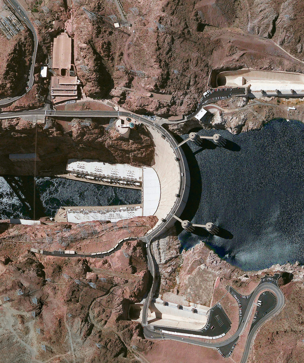 2/16/2016 Hoover Dam Nevada / Arizona, USA 36°0′56″N 114°44′16″W   Hoover Dam is a 726-foot high, 1,244-foot wide concrete arch-gravity dam located on the Colorado River at the border of Arizona and Nevada. Constructed between 1931 and 1936 during the Great Depression, a workforce of approximately 20,000 poured a total of 4.36 million cubic yards of concrete to complete the structure. That is enough concrete to pave a two-lane highway from San Francisco to New York City.