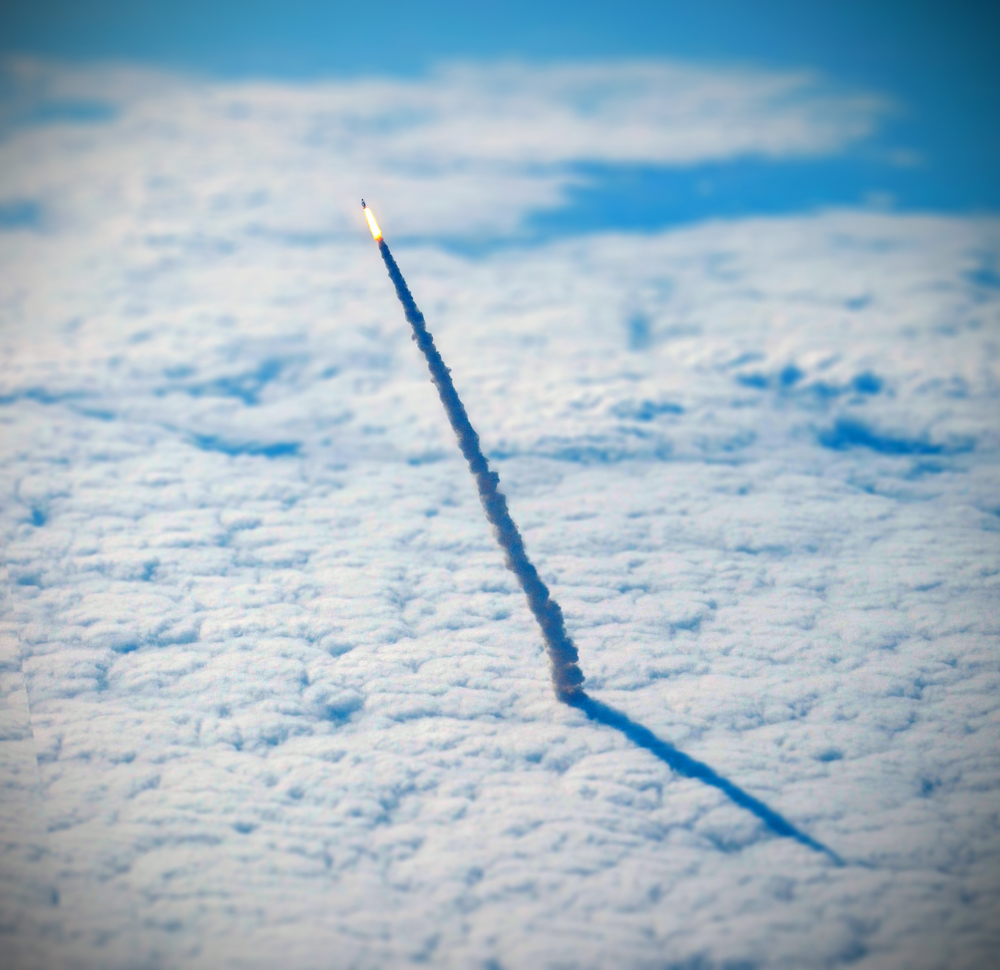 For your daily dose of perspective, here is a photograph of the space shuttle Endeavour, lifting through the clouds during its final launch in May 2011. The photograph was captured from a nearby NASA shuttle training aircraft. Source imagery: NASA