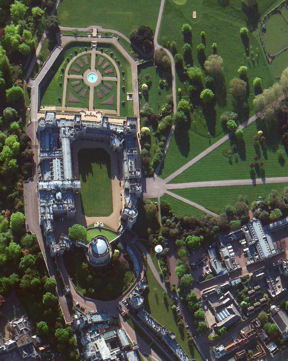 4/21/2016   Windsor Castle   Windsor, England, UK  51°29′0″N 000°36′15″W     Today Queen Elizabeth II celebrates her 90th birthday. Windsor Castle, located in English county of Berkshire and seen in this Overview, is one of her official residences and her preferred weekend destination. More than 500 people live and work in Windsor Castle, making it the largest inhabited castle in the world.