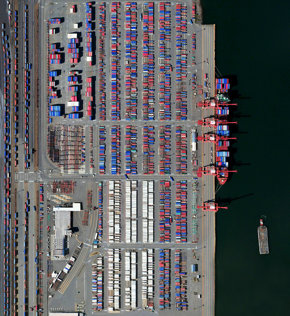 5/8/2016   Port of Seattle   Seattle, Washington, USA  47°36′50″N 122°21′15″W     Today, en route to Portland, I'll be passing through Seattle, Washington. The shipping containers at the city's seaport are seen in this Overview. The facility handles more than two million containers (TEUs) each year, making it the 14th largest port in North America and the 57th largest in the world.