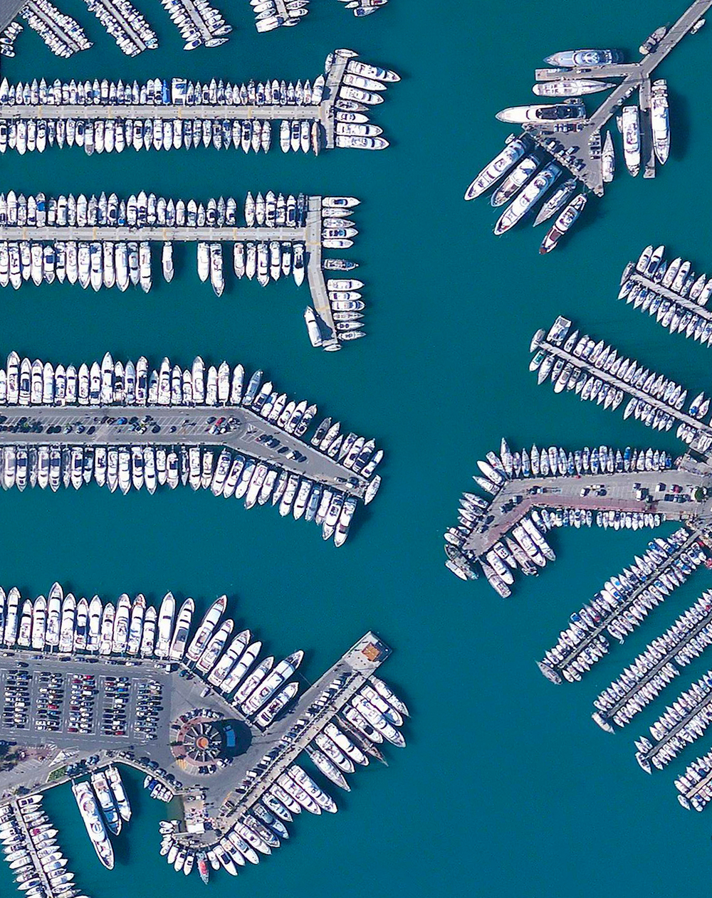 5/19/2016   Port Vauban   Antibes, France  43°35′12″N 7°7′37″E     Massive yachts are docked in the stunning blue water of Port Vauban, a harbor located in Antibes on the French Riviera. The facility is the largest marina on the Mediterranean Sea in terms of total tonnage of the boats that are moored here.