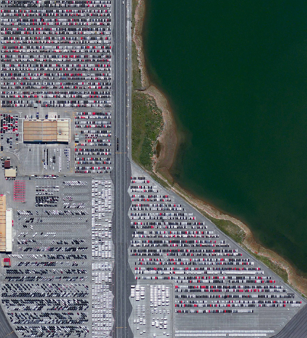 5/25/2016  Port of Santander  Santander, Spain  43.436717, -3.827247     A massive parking lot covers the landscape at the car terminal of the Port of Santander in the Cantabria region of Spain. Recent statistics show that Spain produces roughly 2.4 million cars per year, making it the 9th largest automobile manufacturer in the world and the 2nd largest in Europe after Germany.