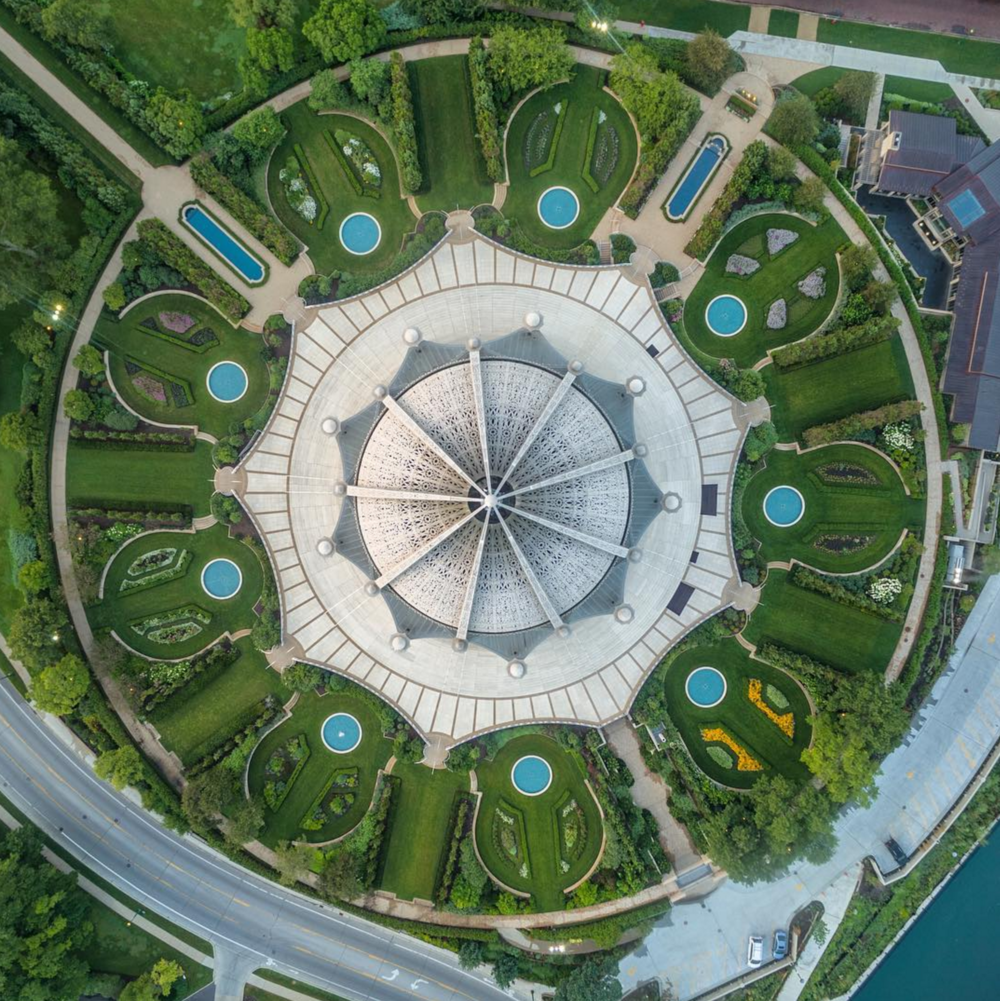 7/26/2015 Bahá'í House of Worship Wilmette, Illinois 42°4′27″N 87°41′3″W   The Baha'i House of Worship in Wilmette, Illinois, is the oldest surviving Baha'i House of Worship in the world and the only one in the United States. The building contains an auditorium that seats 1,191 people beneath a 138 foot-high (42 m) domed structure. You'll also notice that many components of the complex come in sets of nine as the number symbolizes perfection and completion in the Baha'i faith. This incredible shot was captured by @razdood