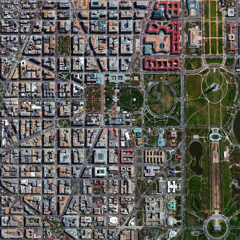 "8/23/2016    L'Enfant Plan    Washington, D.C, USA  38°53′26″N 77°1′13″W     We're continuing this week's focus on urban planning with this Overview of Washington, D.C., USA. The city's L'Enfant Plan was developed in 1791 by Major Pierre Charles L'Enfant for George Washington, the first President of the United States. L'Enfant designed a compass-aligned grid for the city's streets, with intersecting diagonal avenues that were later named after the states of the union. The diagonal avenues also intersect with the north-south and east-west streets at circles and rectangular plazas in order to create more open, green spaces. Lastly, L'Enfant laid out a 400 foot-wide (122 meter) garden-lined ""grand avenue"" - what is now know as the National Mall – that connects the US Capitol Building, the Washington Monument, and the Lincoln Memorial (the latter two are visible at right in this Overview)."