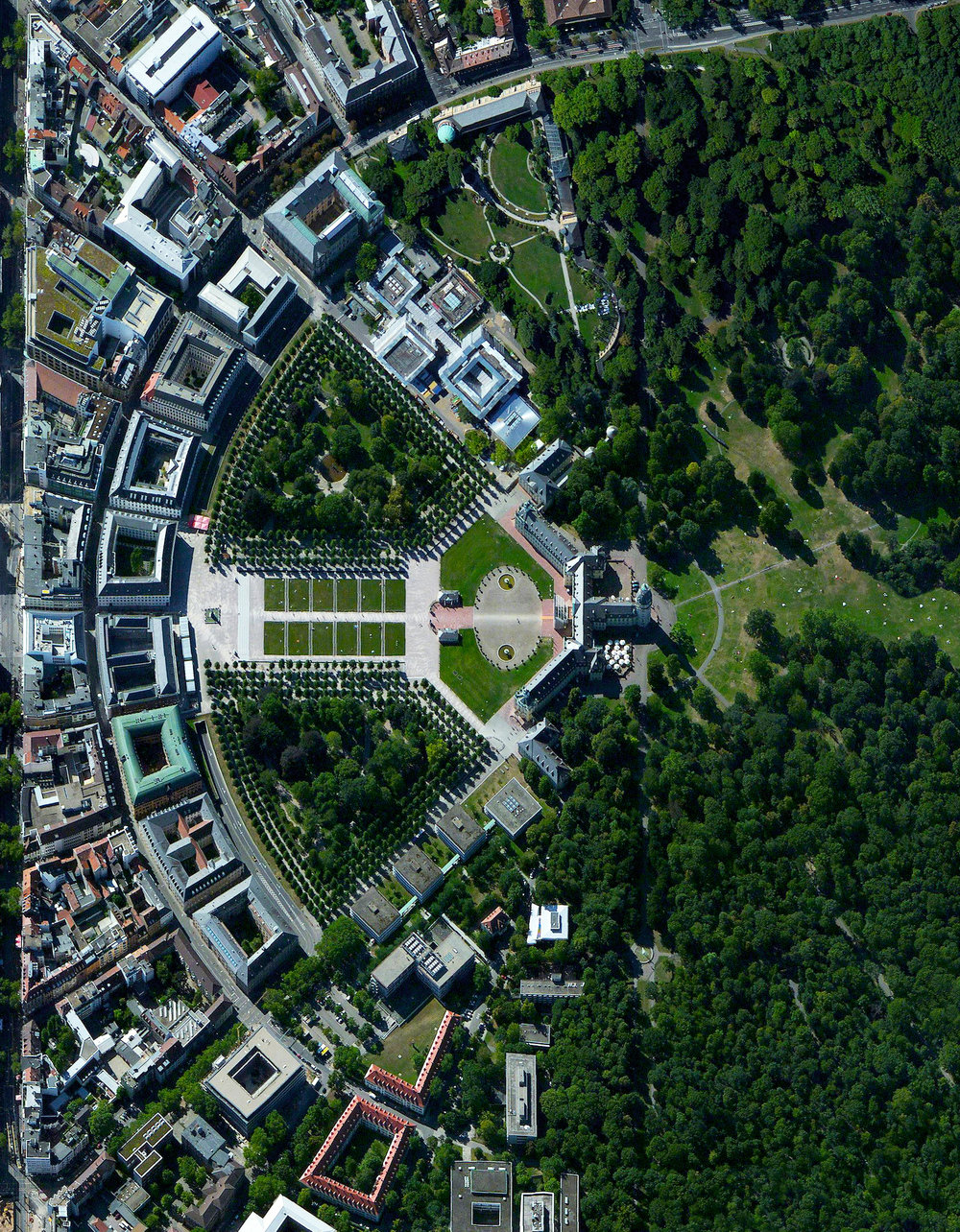 "8/24/2016 Karlsruhe, Germany 49°00′33″N 8°24′14″E   The city of Karlsruhe, Germany was planned with a palace tower at its center, surrounded by 32 radiating streets. Because the design resembled the ribs of a folding fan, the city is sometimes called the ""fan city"" or ""Fächerstadt."" Additionally, this city's urban plan gave rise to the geometry concept of ""Karlsruhe Metric"" which refers to a measure of distance that assumes travel is only possible along radial streets and along circular avenues around the center."
