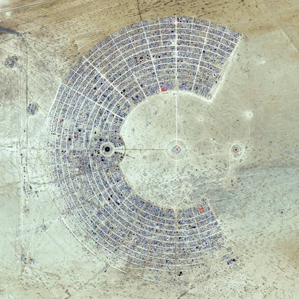 8/25/2016   Burning Man   Black Rock City, Nevada, USA  40°47′13″N 119°12′16″W      Over the next few days, thousands of people from around the world will head to the desert in Nevada, USA to construct Black Rock City. Laid out in a grid plan with radiating avenues named after the numbers on a clock, the city serves as home to roughly 60,000 people for Burning Man, an annual week-long event. Burning Man is described as an experiment in community, art, self-expression, and radical self-reliance. Additionally residents in Black Rock City practice one of the event's key principles of 'Leave No Trace' – meaning significant efforts are taken to make sure as the city is disassembled in the days following the festival, the desert returns to its original state.