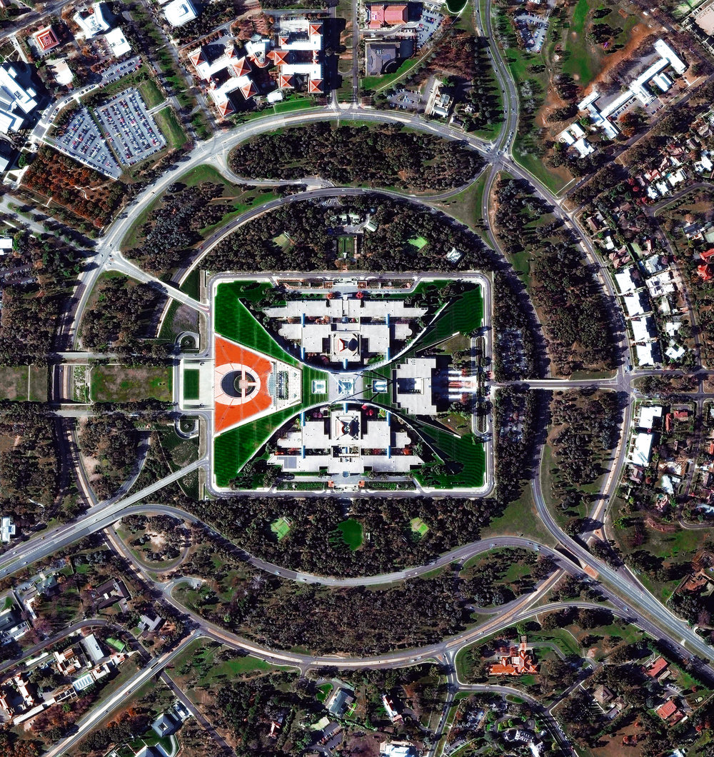 8/27/2016 Capital Hill Canberra, Australia 35°18′29″S 149°07′28″E   The construction of Parliament House in Canberra, Australia involved the removal of the top half of Capital Hill (the mound on which the structure was built). After the project was completed, much of the displaced earth was replaced on top of the building where a lush, green lawn now grows. While much of Canberra was designed by by Walter Burley Griffin in 1913, this specific complex opened in 1988, is designed to look like two boomerangs, and contains approximately 4,400 rooms.