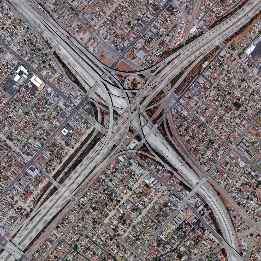 9/13/2016 Judge Harry Pregerson Interchange Los Angeles, California 33.9287°N 118.281°W   Today I'll be traveling throughout the freeway network of Los Angeles, well known for its massive interchanges (and traffic). The Judge Harry Pregerson Interchange is a stack highway interchange located near the Athens and Watts neighborhoods in South LA. This junction is composed of five levels that scale to a staggering height of more than 40 meters (132 feet).