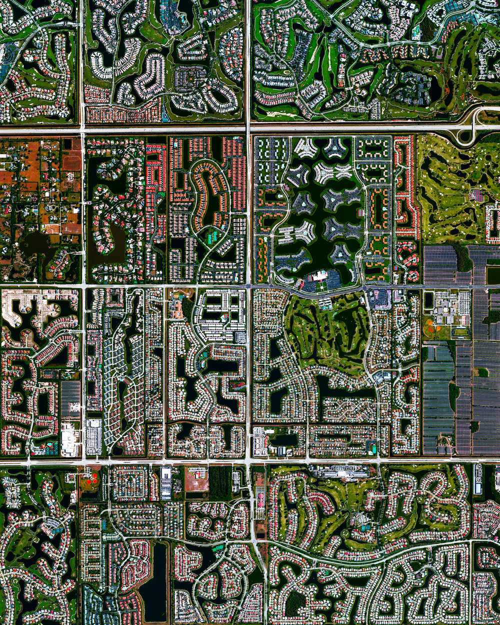 9/22/2016   Boca Raton, Florida    26.386332°, – 80.179917°      Residential development is seen in Boca Raton, Florida, USA. Because many cities in the state contain master-planned communities, often built on top of waterways in the latter half of the twentieth century, there are a number of intricate designs that are visible from the Overview perspective. Boca Raton is home to roughly 91,000 residents.