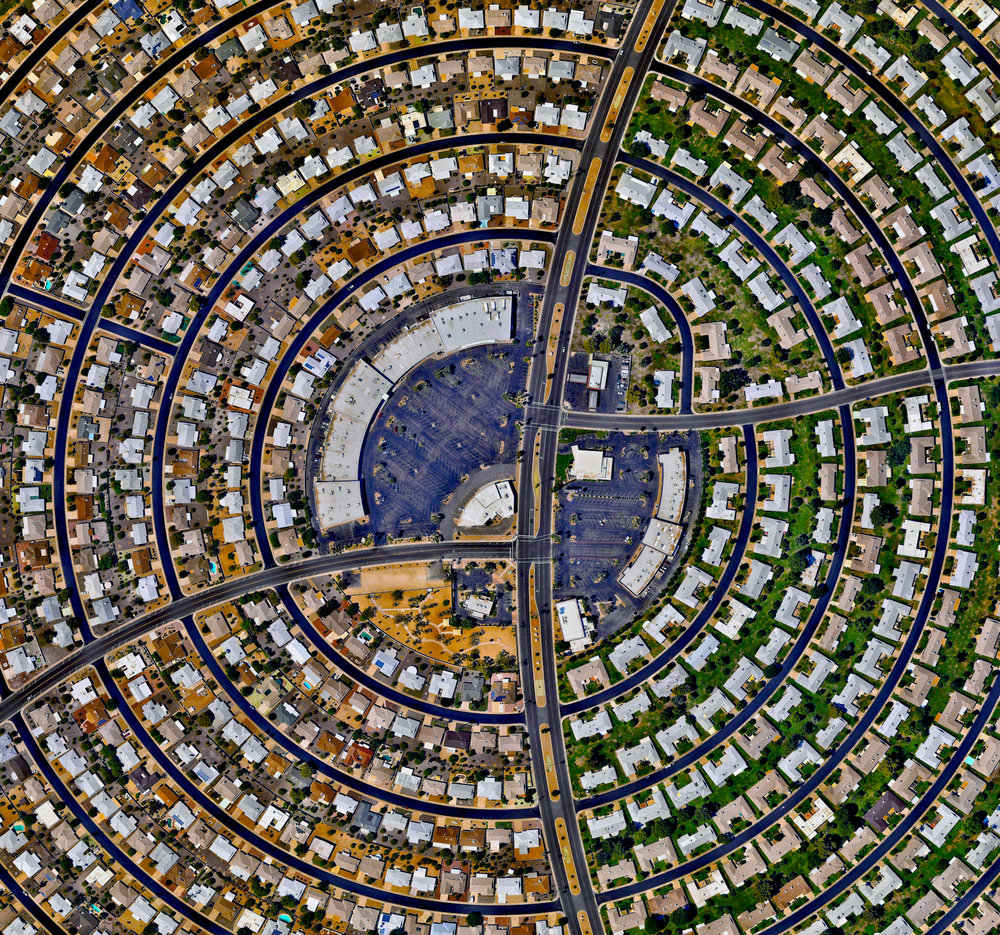 "9/23/2016 Sun City Sun City, Arizona, USA 33.6189504, -112.291099   Houses, built in concentric circles, make up a section of Sun City, Arizona, USA. When the development opened on January 1, 1960, the event attracted a crowd of more than 100,000 onlookers and the ""futuristic development"" was featured on the cover of Time magazine."