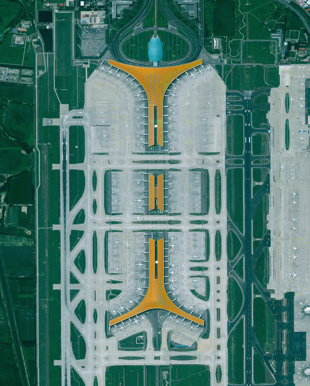 11/16/2016   Beijing Capital International Airport   Beijing, China  40°04′21″N 116°35′51″E     Beijing Capital International Airport is the second busiest airport in the world, handling more than 90 million passengers every year. The dragon-like layout of the terminals is meant to celebrate the thrill and poetry of flight, while the orange roof evokes the vibrant coloration of the city's famed Forbidden City.