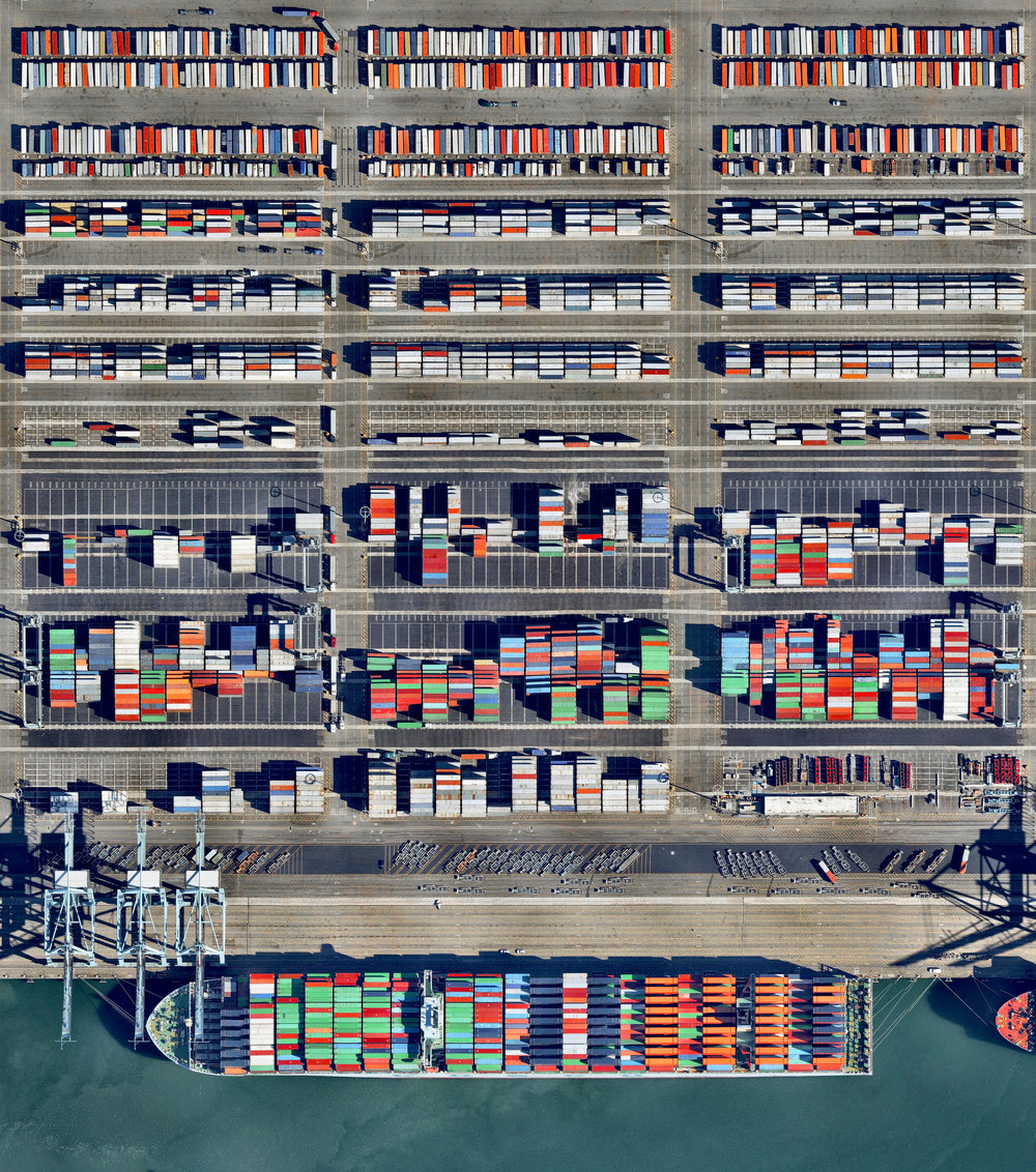 12/5/2016 Port of Long Beach Long Beach, California 33.754185°N 118.216458°W   Shipping containers are loaded into a massive cargo ship (1200+ feet) at the Port of Long Beach — the second-busiest container port in the United States. The seaport generates approximately $100 billion in trade, employs more than 316,000 people, and along with the Port of Los Angeles to which it is connected, serves as the single largest source of air pollution in the metropolitan LA area.   Source imagery: Nearmap