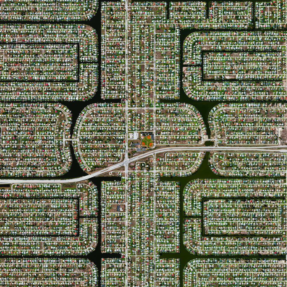 12/16/2016  Residential development  Cape Coral, Florida  26.604391°, –81,958473°     I'm heading home from Florida today and excited that I'll have the window seat. Because many cities in the state contain master-planned communities, often built on top of waterways in the latter half of the twentieth century, there are a number of intricate designs that are visible from the Overview perspective. Here is one particular development in Cape Coral, a city with a population of 165,831 people.
