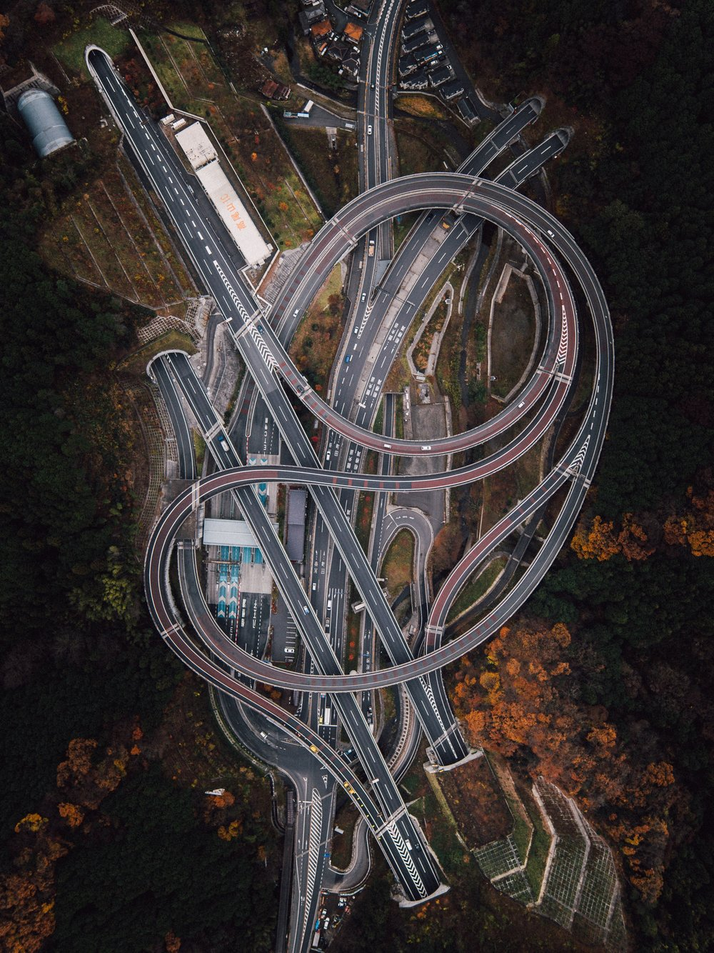 Check out this incredible drone capture of a roadway interchange outside of Sagamihara, Japan. Nestled within the mountains, you'll notice the junction is particularly fascinating as it connects not just normal roads, but tunnels. 35.636875, 139.25271 Drone photo by Rob Antill and Ben Steensls