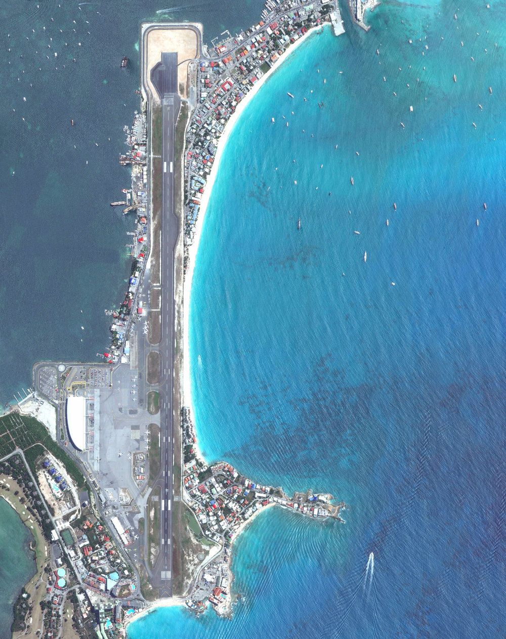 3/20/2017 Princess Juliana International Airport Saint Martin 18.040823°, -63.109948°   Princess Juliana International Airport is the main airport on the Caribbean island of Saint Martin. The airport is well-known for the approach to Runway 10, seen at the bottom of this Overview. Here arriving aircraft must have a 3° glide slope, flying at a shockingly low altitude over people relaxing on Maho Beach, to land safely.
