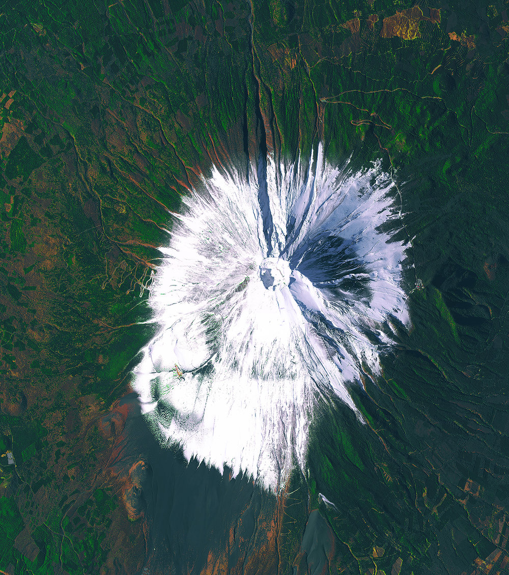 4/3/2017  Mount Fuji  Japan  35.358056, 138.731111  Standing at 12,389 ft, Mount Fuji is the tallest mountain in Japan. Fuji is an active volcano that last erupted December 16, 1707. The eruption did not result in any immediate deaths, but many people died as a result of the volcanic ash that significantly reduced agricultural production, causing many people to starve. It is estimated that between 200,000 and 400,000 people climb Mount Fuji every year.  Source imagery: DigitalGlobe