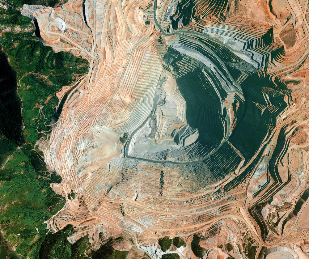 4/4/2017 Bingham Canyon Mine Salt Lake City, Utah 40.523000, -112.151000 The Bingham Canyon Mine is an open-pit mine in Salt Lake City, Utah. At 2.5 miles wide and 0.6 miles deep, it is the largest man made excavation in the world. On April 10th, 2013, a landslide took place at the pit that was the single largest non-volcanic landslide to ever happen in North America. The amount of debris that fell into the mine was roughly equivalent to 1/6 of the volume of all humans alive on Earth. Source imagery: DigitalGlobe