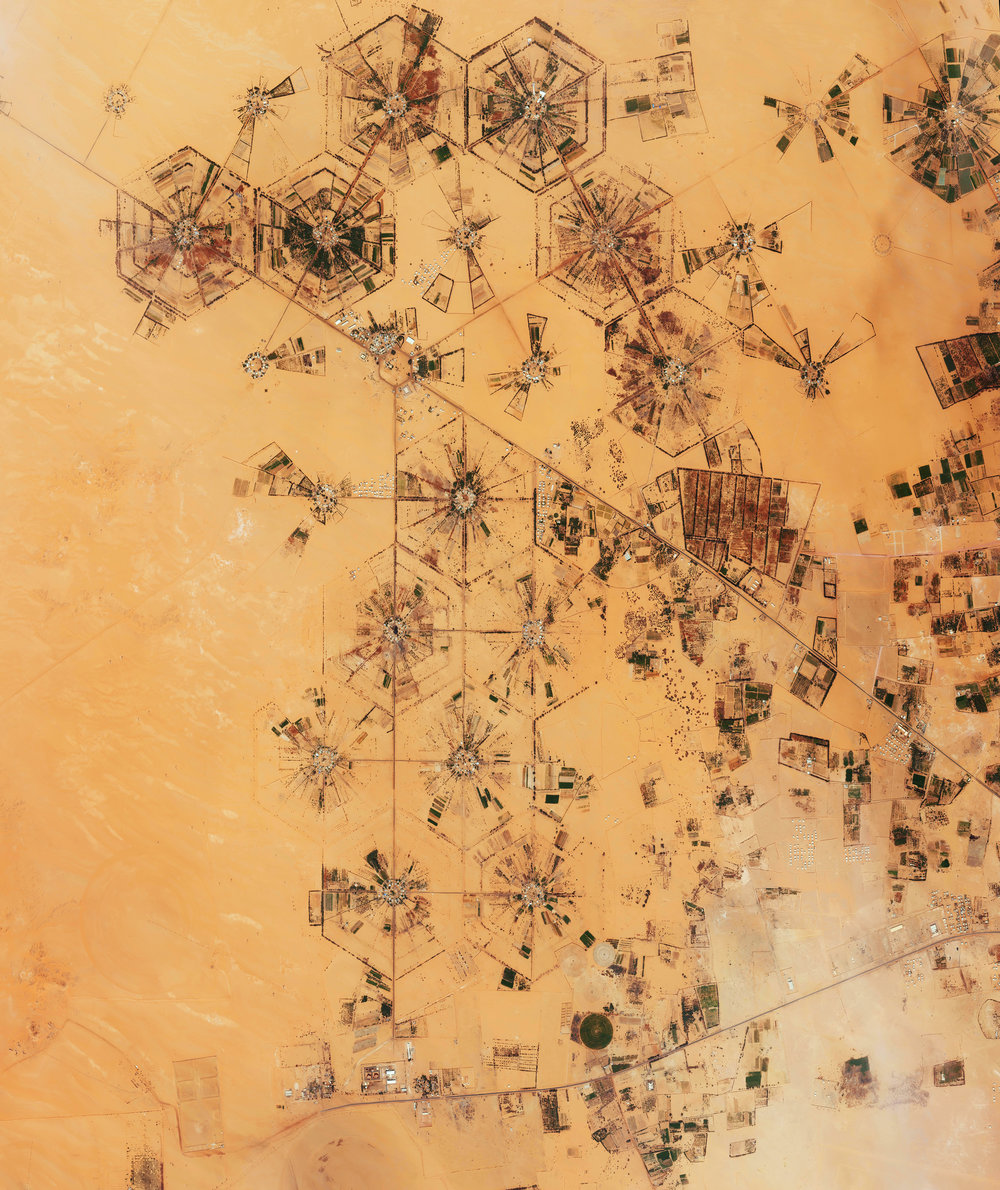 4/10/2017 The Kufra Basin Libya 24.129228, 23.218823 The Kufra Basin in the Sahara Desert of Libya is one of the most heavily irrigated oases in the world. The Libyan government enacted a plan in the 1970's to enable agricultural cultivation in the desert by extracting water from the Nubian Sandstone Aquifer System, a non-renewable source of fossil water located beneath the surface. Because the area receives only one inch of rain per year, the acquirer is now nearly dried up. Source imagery: DigitalGlobe