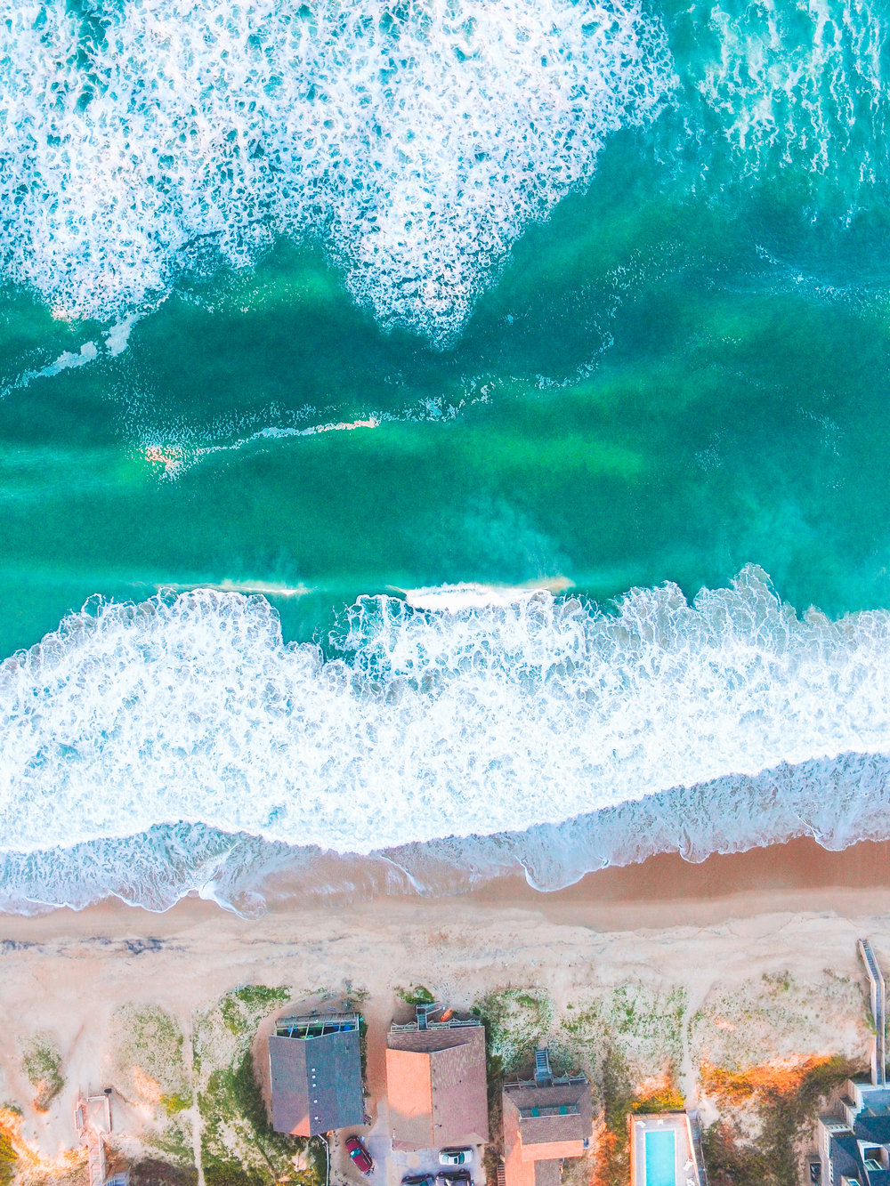 4/29/2017 I captured this drone shot last week in Outer Banks, North Carolina. The OBX is a popular vacation destination with numerous beaches and state parks. This particular flight took place over the waves of Nags Head. -Micah Marshall