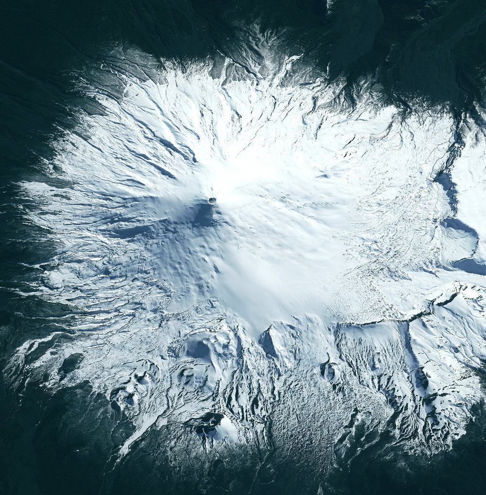 5/4/2017  Villarrica  Chile  -39.423184, -71.939279  Villarrica, a volcano in the Chilean Central Valley, is one of the few volcanoes in the world with a lava lake in its crater. Rising 2,860 m (9,380 ft), Villarrica covers an area of 400 square kilometers. The volcano's most recent serious eruption was in 2015, which caused the evacuation of thousands of people in nearby communities.  Source imagery: DigitalGlobe