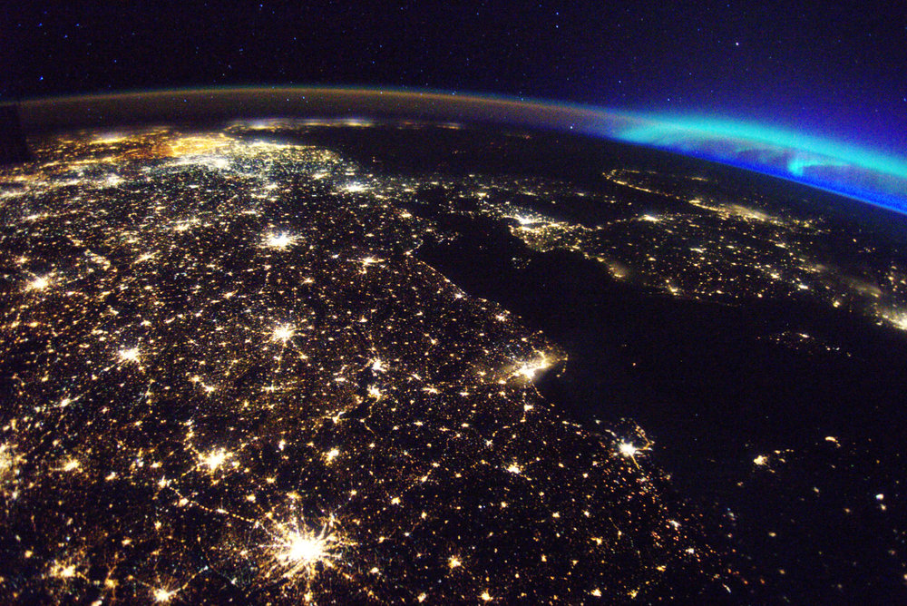 5/13/2017 Western Europe  Europe Check out this stunning view of Western Europe with the the aurora borealis in the background from the International Space Station! This photo was taken 250 miles above our home planet by astronaut Thomas Pesquet. The major cities of Germany and Belgium are both illuminated in this shot. Photo taken by Thomas Pesquet