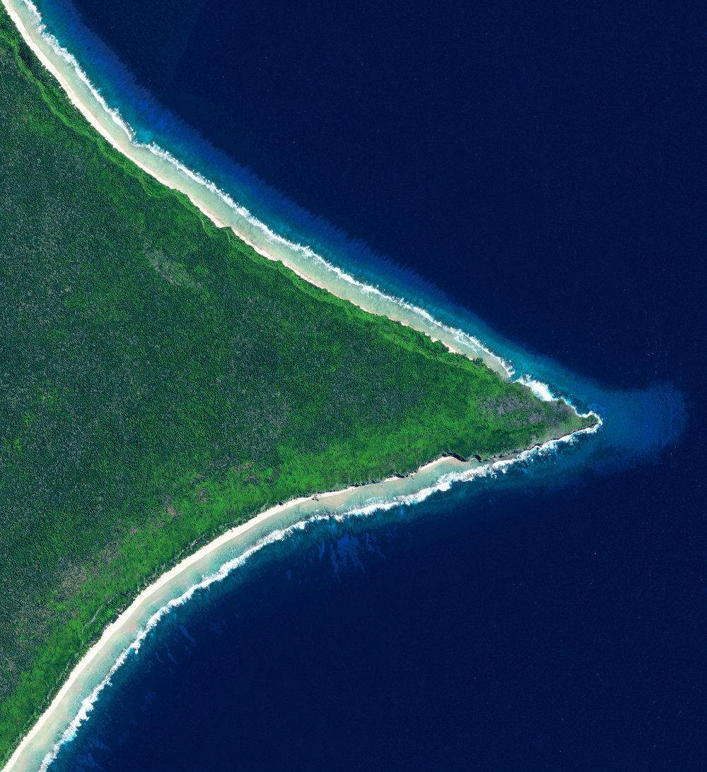 Henderson Island   Pitcairn Islands  -24.335178, -128.310435  Henderson Island is a 14.4 square mile uninhabited landmass in the South Pacific Ocean. Recent studies have revealed that this area has the highest density of plastic that has washed up onshore of any area on the globe. It is estimated that the island's shores now contain 37.7 million items of debris that weigh a total of 17.6 tonnes.  Source imagery: Digitalglobe
