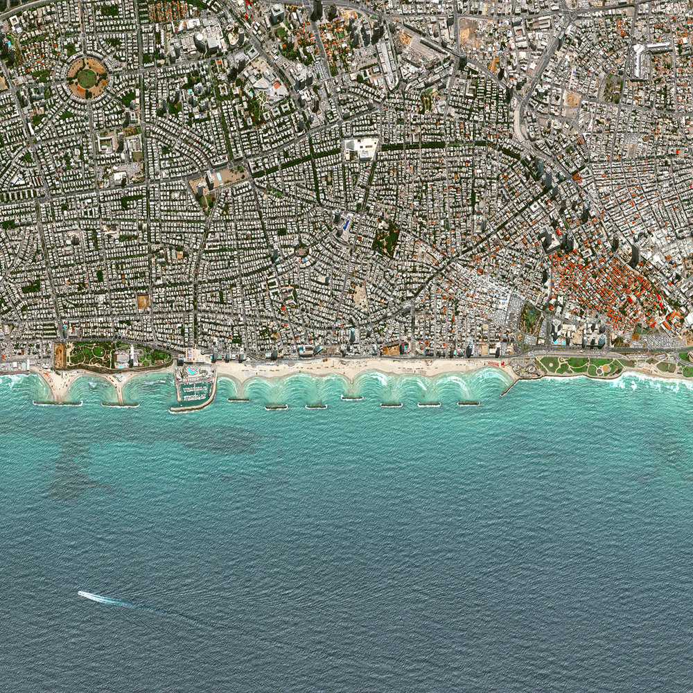 5/24/2017  Tel Aviv  Israel   32.086413, 34.766969  Located on the coast of the Mediterranean Sea, Tel Aviv is the second largest city in Israel and is recognized as the country's financial center and a major technology hub. With a city plan dating back to the 1920's, Tel Aviv was constructed with a hierarchical system of streets laid out in a grid and large blocks consisting of small-scale dwellings that surround central, open spaces.  Source imagery: DigitalGlobe
