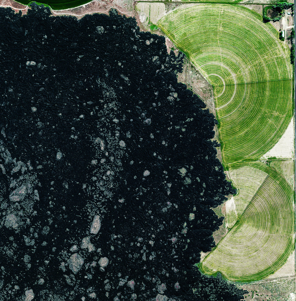 6/8/2017 Lava Field Millard County, Utah, USA 38.968922, -112.472327  Pivot irrigation fields surround a lava field known as The Cinders, in Millard County, Utah. Along with farming, one of the elements of Millard County's economy is fossil digging as Trilobite fossils are relatively common in the region west of Delta.