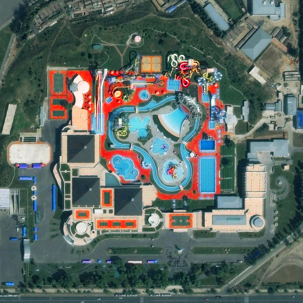 Munsu Water Park is located in Pyongyang, North Korea. The facility is open year-round with water slides, indoor and outdoor swimming pools, various sport courts, and a rock climbing wall. 39.039177°, 125.780009°