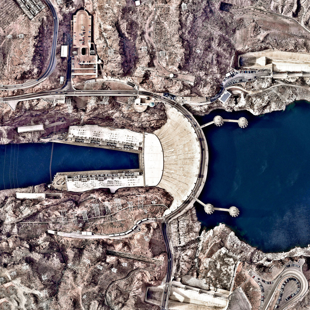 Hoover Dam is a 221-meter-high (726-foot), 379-meter (1,244-foot) concrete arch-gravity dam, located on the Colorado River at the border of Arizona and Nevada, USA. Constructed between 1931 and 1936 during the Great Depression, a workforce of approximately 20,000 poured a total of 3.33 million cubic meters (4.36 million cubic yards) of concrete to complete the structure – enough to pave a two-lane highway from San Francisco to New York City.  36.015844°, – 114.738804°