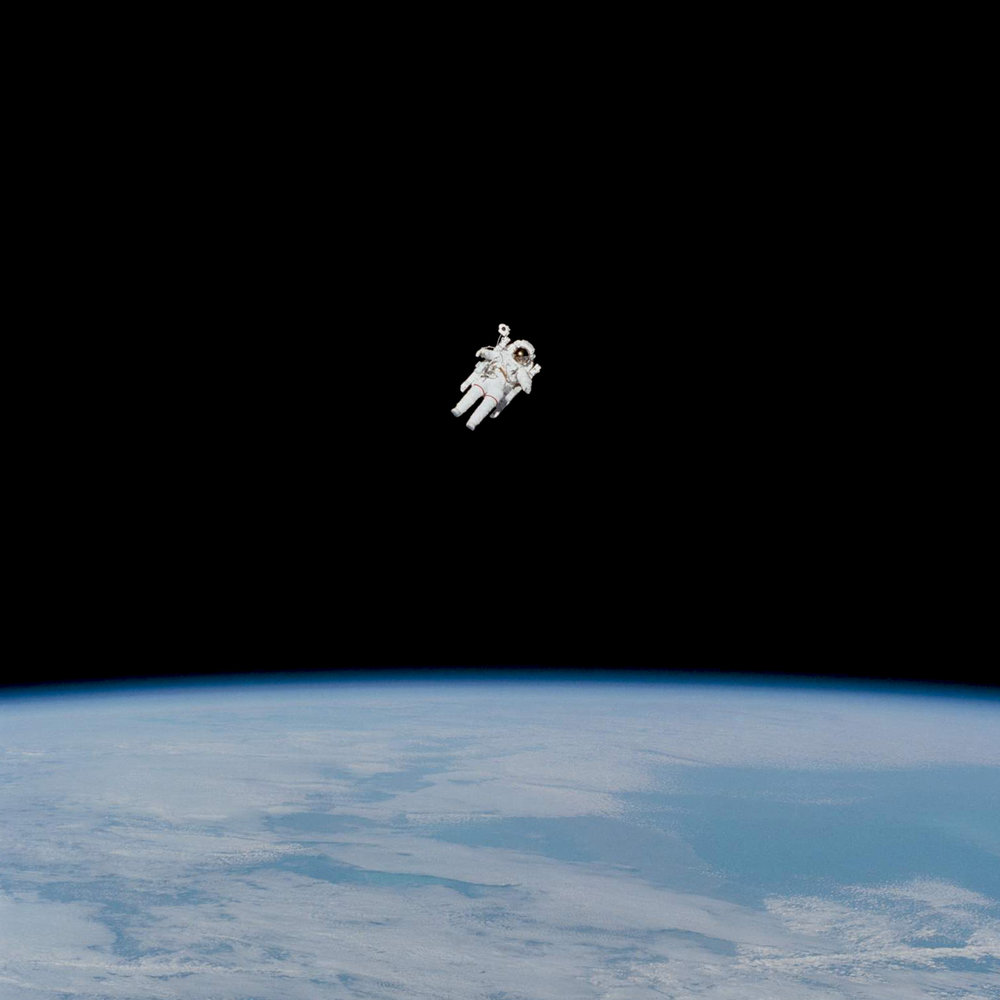 """On February 7, 1984 astronaut Bruce McCandless conducted the first untethered spacewalk. We were deeply saddened to hear of his passing a few days ago at the age of 80. In this iconic photograph captured by his fellow crewmembers aboard the Space Shuttle Challenger, Mccandless is approaching his maximum distance from the vehicle. Following the walk, when asked to describe the panorama with the Earth below him, McCandless remarked """"It really is beautiful.""""  Source imagery: @NASA"""