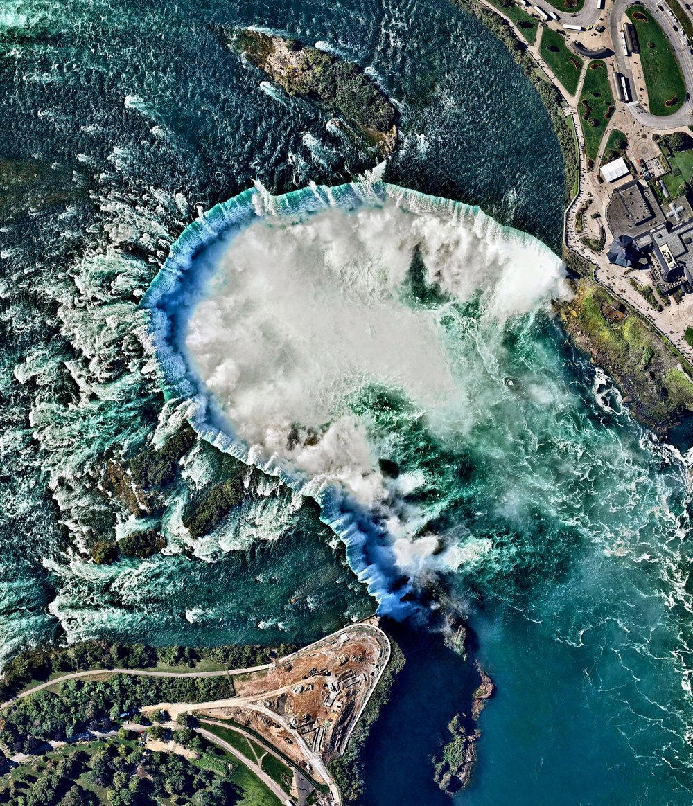 Here's another favorite from 2017 — Niagara Falls is the collective name for three waterfalls that straddle the border between Ontario, Canada and the United States. Horseshoe Falls is seen here. The falls have the highest flow rate of any waterfall in the world, with a vertical drop of more than 165 feet (50 meters). The Maid of the Mist, also visible here, is a boat that has carried passengers into the rapids below the falls since 1846.  Source imagery: Nearmap